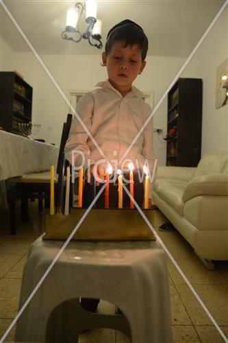 Lighting Hanukkah candles