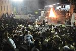 Light and dancing around Lag Ba'Omer bonfire